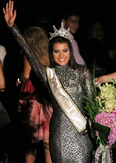 Mina Milutinovic of Serbia celebrates after winning the title of Miss World Next Top Model 2012 during the final contest in Beirut.(Anwar Amro/Getty Images)