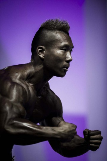 A competitor poses for a picture during the 2012 International Bodybuilding and Fitness Invitation Championship in Hong Kong. (Philippe Lopez/AFP)