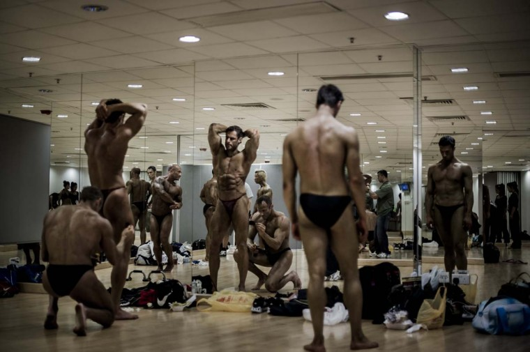 Competitor get ready during the 2012 International Bodybuilding and Fitness Invitation Championship in Hong Kong. (Philippe Lopez/AFP)