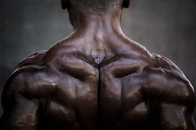 A competitor exercises as he waits backstage during the 2012 International Bodybuilding and Fitness Invitation Championship. (Philippe Lopez/AFP)