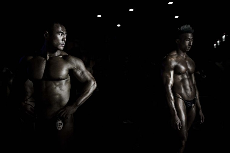 Competitors wait backstage during the 2012 International Bodybuilding and Fitness Invitation Championship in Hong Kong. (Philippe Lopez/AFP)