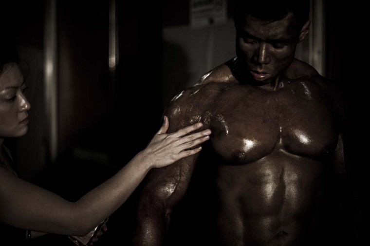 A competitor gets tanning product applied during the 2012 International Bodybuilding and Fitness Invitation Championship in Hong Kong. (Philippe Lopez/AFP)