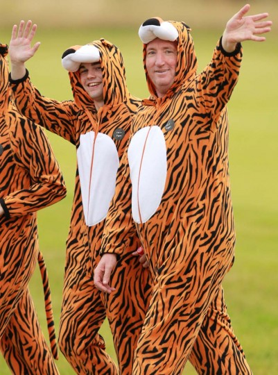 Golf spectators wearing tiger suits wait for Tiger Woods of the US during practice at Royal Lytham & St Anne's in Lytham, north-west England ahead of the 2012 British Open Golf Championship which begins on July 19. (Peter Muhl/Getty Images)