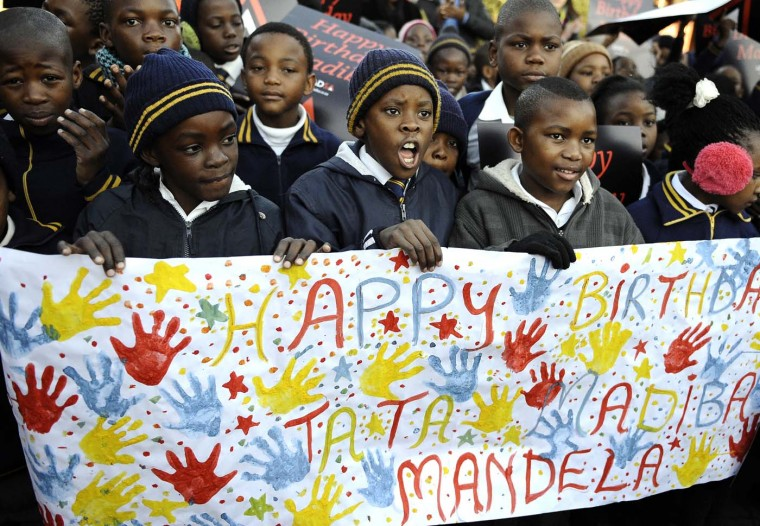 "South African schoolchildren sing happy birthday to former South African President Nelson Mandela as he turned 94 on July 18, 2012 at Batsogile Primary School in Soweto. The nation's 12 million schoolchildren began their day with a special birthday song, ringing with the line: ""We love you father."" (Stephane de Sakutin/AFP/Getty Images)"