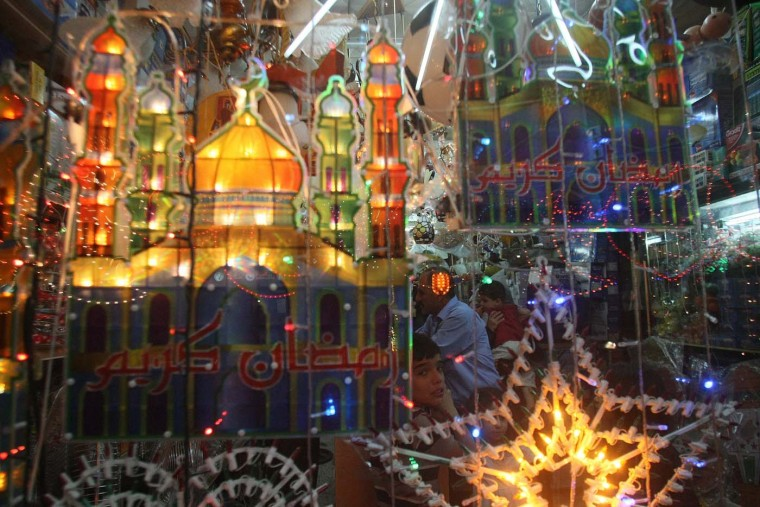 Ramadan decorations are hung outside a shop in the West Bank city of Hebron on July 18, 2012, to welcome the upcoming Muslim holy fasting month of Ramadan. (Hazem Bader/AFP/Getty Images)