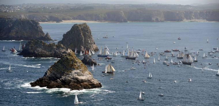 "Sailboats parade in the Crozon bay, western France, during the 2012 ""Tonnerres de Brest"" maritime festival, which features thousands of traditional sailboats July 19, 2012. (Fred Tanneau/AFP/Getty Images)"