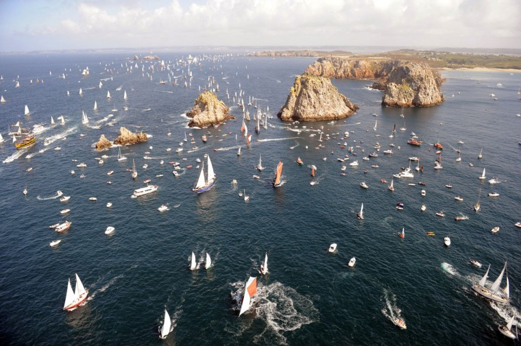 "Sailboats parade on July 19, 2012 in the Crozon bay, western France, during the 2012 ""Tonnerres de Brest"" maritime festival which features thousands of traditional sailboats from 13 to 19 July 2012. (Fred Tanneau/AFP/Getty Images)"