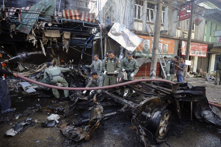 Members of a Thai bomb squad unit inspect the site of a car bomb attack in Thailand's southern Narathiwat province on July 20, 2012. Two civilians were killed and four wounded in bomb and shooting attacks in southern Thailand, a military spokesman said. (Madaree Tohlalama/AFP/Getty Images)