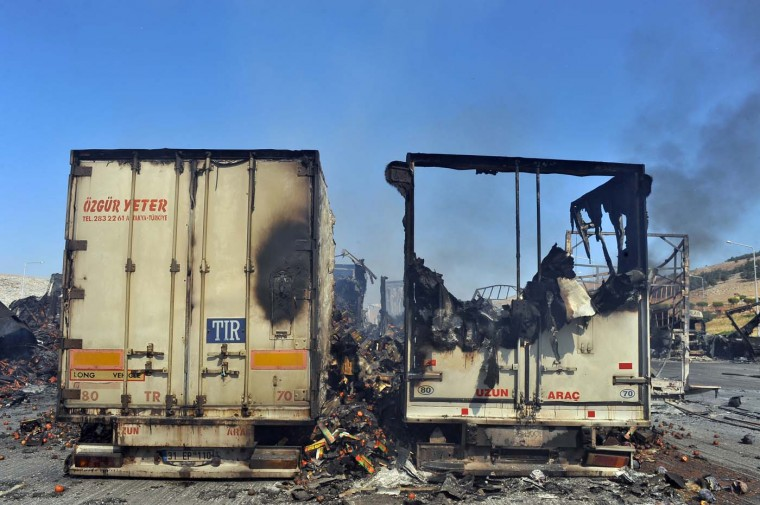 A picture taken on July 20, 2012 shows burnt-out lorries at the Bab al-Hawa border post. Some 150 armed rebel fighters took control of the post, which lies opposite Turkey's Cilvegozu border crossing in the southern province of Hatay. (Bulent Kilic/AFP/Getty Images)