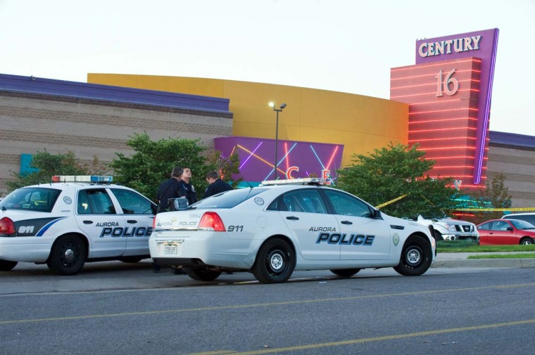 """Police cars in front of the Century 16 theater in Aurora, Colorado where a gunman opened fire during the opening of the new Batman movie """"The Dark Knight Rises"""" killing at least 10 people and wounding over 30 others. (Jonathan Castner/Getty Images)"""