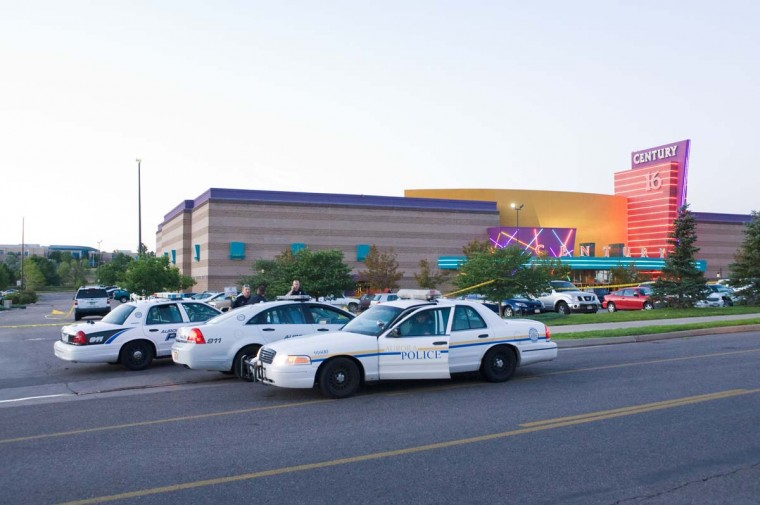 "Police cars in front of the Century 16 theater in Aurora, Colorado where a gunman opened fire during the opening of the new Batman movie ""The Dark Knight Rises"" killing at least 10 people and wounding over 30 others. (Jonathan Castner/Getty Images)"
