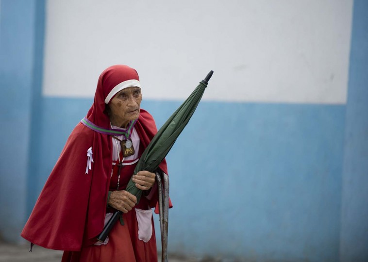 A woman dressed in religious attire walks by the church of Our Lady of the Rosary on July 18, 2012 at Nueva Jerusalen community in Michoacan, Mexico. Nueva Jerusalen was founded 1973 after peasant woman Gabina Romero said that Our Lady of the Rosary had materialized before her with the message to found a community of penitents to save the world. (Yuri Cortez/AFP/Getty Images)