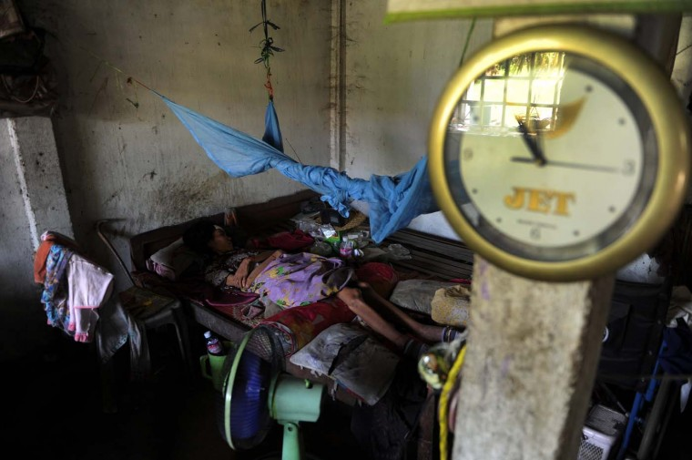 A Cambodian woman who is living with HIV lays on a bed inside her home at Batty district in Takeo province, some 70 kms south of Phnom Penh on July 23, 2012. About 34 million people were living with HIV at the end of 2010, according to the World Health Organization. (Tang Chhin Sothy/AFP/Getty Images)