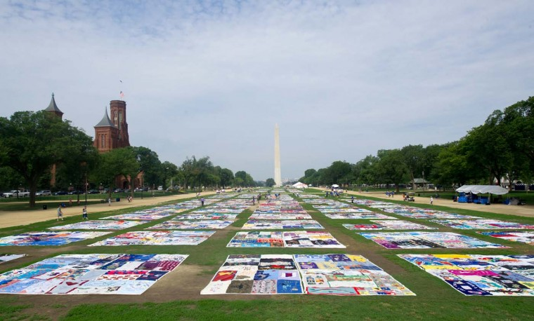 The AIDS Quilt is laid out on the National Mall July 23, 2012 as part of the 19th International AIDS Conference in Washington, DC. The conference is expected to draw 25,000 people, including politicians, scientists and activists, as well as some of the estimated 34 million people living with HIV who will tell their stories. (Karen Bleier/AFP/Getty Images)
