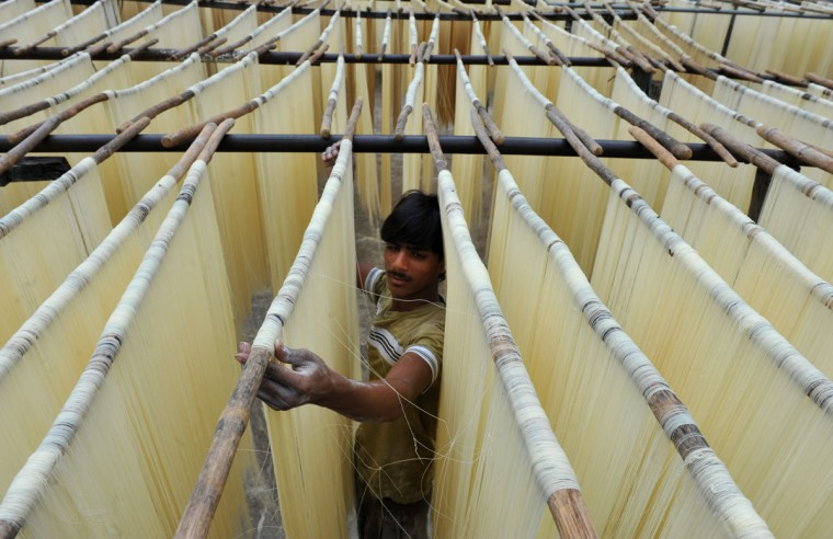 An Indian worker dries Seviiyan, thin vermicelli, which is used for the preparation of sheerkhorma, a traditional sweet dish prepared by the Muslim community during the month of Ramadan, at a food factory in Hyderabad. Like millions of Muslim around the world, Indian Muslims celebrated the month of Ramadan by abstaining from eating, drinking, and smoking as well as sexual activities from dawn to dusk. (Noah Seelam/AFP/Getty Images)