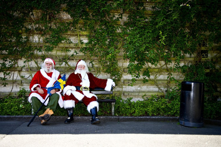 Two men dressed as Santa Claus rest on a bench during a visit by the participants of the annual World Santa Claus Congress to the Copenhagen Zoo in Denmark. (Torkil Adsersen/AFP/Getty Images)