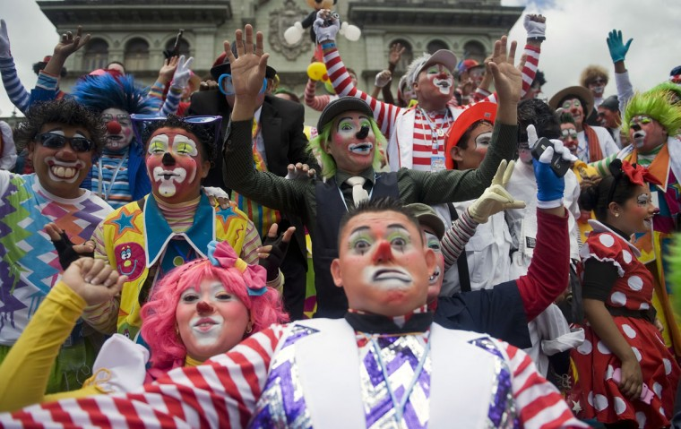 A group of clowns pose for the camera during a parade in the historic centre of Guatemala City in the framework of the IV Latin American Clown Congress (Johan Ordonez/AFP/Getty Images)