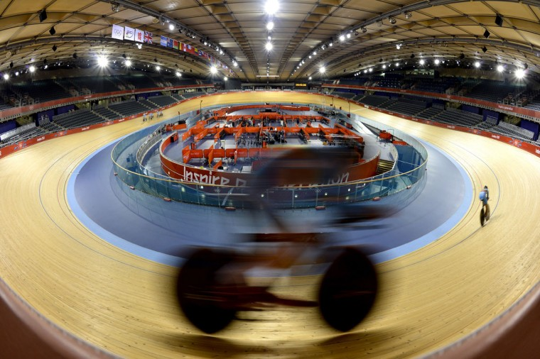 A rider from the Belgium track cycling team trains at the Velodrome in the Olympic Park in East London on July 25, 2012 two days before the start of the London 2012 Olympic Games. (Odd Andersen/AFP/Getty Images)