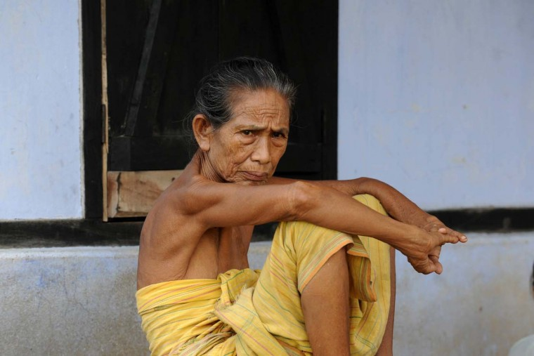 A displaced Bodo villager sits in Gosaigaon village at Kokrajhar district in the northeastern state of Assam on July 26, 2012. Large troop deployments appear to have stemmed an outburst of ethnic violence in northeast India, officials said Thursday, after a week of clashes that left at least 45 people dead. (Dipetndu Dutta/AFP/Getty Images)