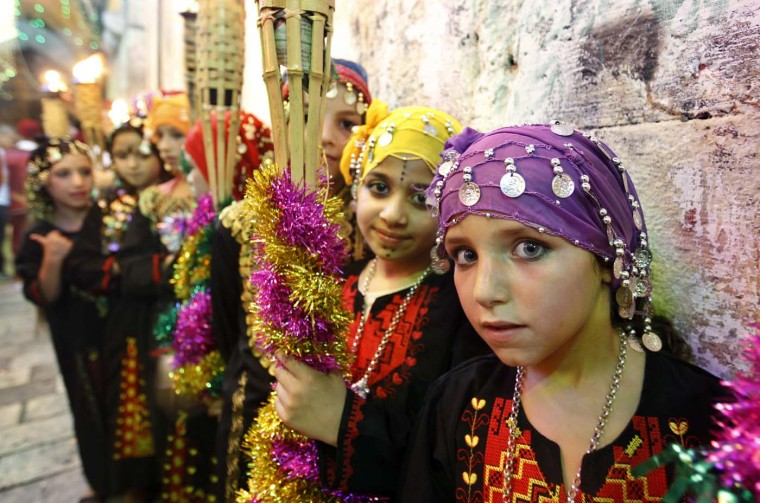 Children perform in Jerusalem's Old City during celebrations to mark the breaking of the fast on the seventh day of the holy month of Ramadan, on July 26, 2012. (Ahmad Gharabli/AFP/Getty Images)