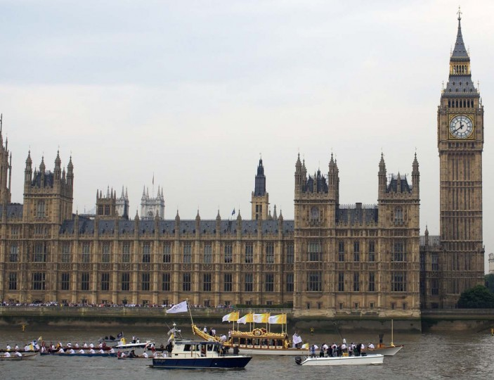 LONDON, UNITED KINGDOM - JULY 27: The Gloriana with the Olympic torch sails down the river Thames past the houses of Parliament on the final day of the Olympic torch relay where it will end in the London Olympic Stadium for the opening ceremony of the 2012 London Olympics, on July 27, 2012. (Andrew Cowie/AFP/Getty Images)
