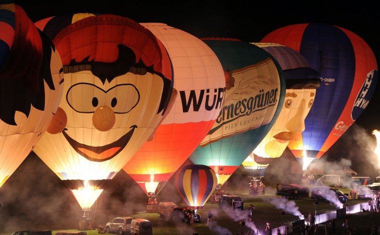 Hot air balloons glow during the International Balloon Fiesta in Leipzig, eastern Germany, on July 26, 2012. Within the coming four days more than 40 hot air balloons and airships participate in the festival. (Hendrik Schmidt/AFP/Getty Images)