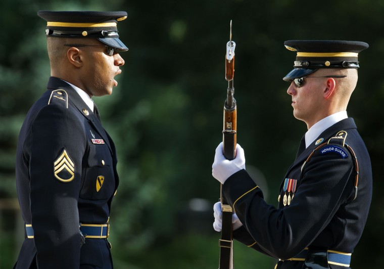 "A US Army Honor Guard (R) is inspected as his Sergeant(L) oversees the change over the duty of guarding the Tomb of the Unknown Soldier shortly before the start of the ""Heroes Remembered"" commemoration of the 59th anniversary of the Korean War Armistice in the amphitheater of Arlington National Cemetery July 27, 2012, in Arlington,Virginia. The Armistice was signed in Panmunjom, Korea, July 27th, 1953, after three years of bloody fighting between the US-led United Nations, the People's Republic of China, North Korea, and South Korea. (Paul J. Richards/AFP/Getty Images)"