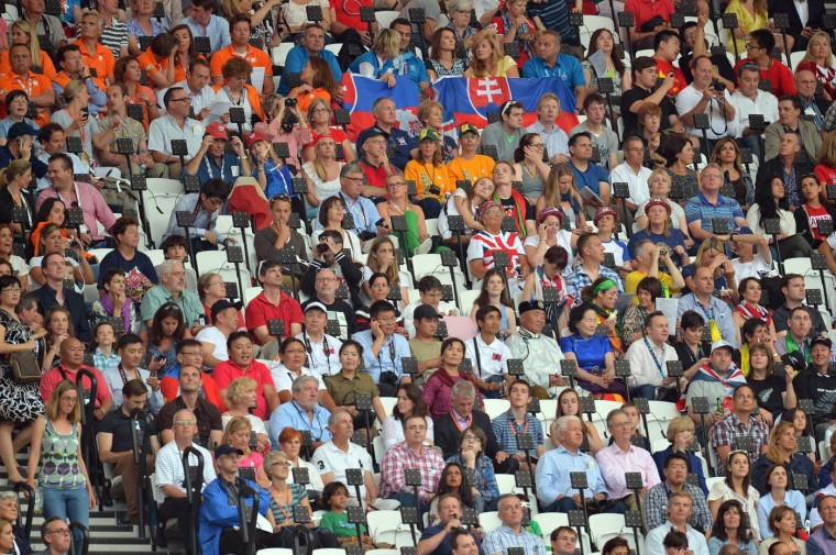 People wait prior to the start of the opening ceremony of the London 2012 Olympic Games on July 27, 2012 at the Olympic Stadium in London. (Jewel Samad/AFP/Getty Images)