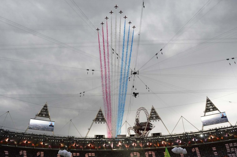 The Red Arrows fly over the Olympic Stadium prior to the start of the opening ceremony of the London 2012 Olympic Games on July 27, 2012 in London. (Adrian Dennis/AFP/Getty Images)
