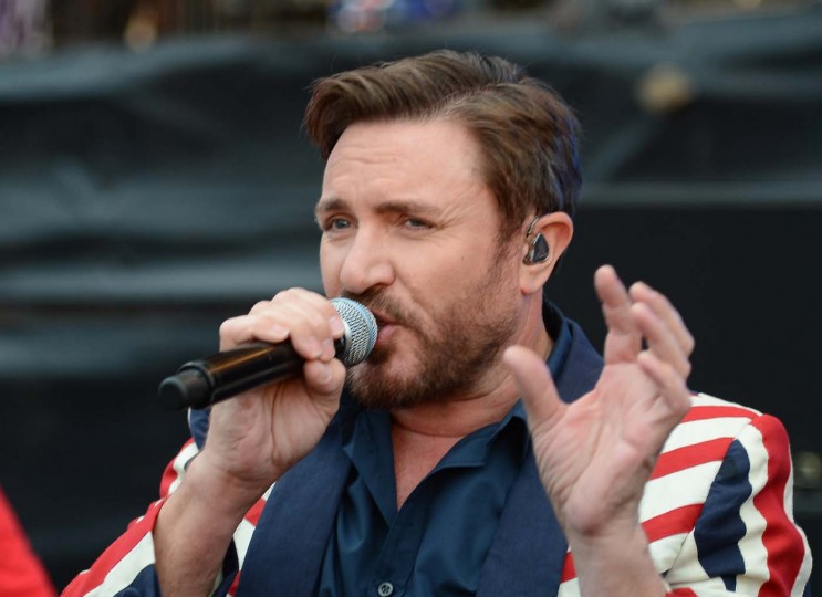 British singer Simon Le Bon from the band Duran Duran performs on stage during the BT London Live Concert at Hyde Park in London on July 27, 2012, to celebrate the opening ceremony of the London 2012 Olympic Games. (Miguel Medina/AFP/Getty Images)
