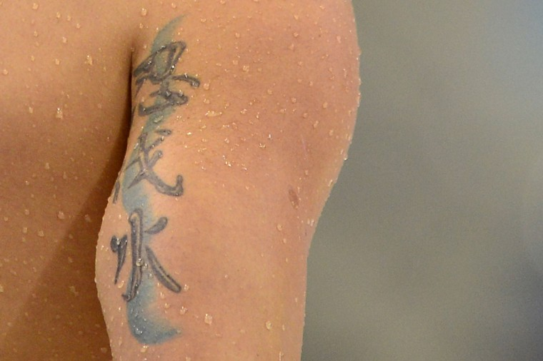 The tattoo of Brazil's Thiago Pereira is seen after the men's 200m individual medley heats swimming event at the London 2012 Olympic Games on August 1, 2012 in London. (Fabrice Coffrini/AFP/Getty Images)