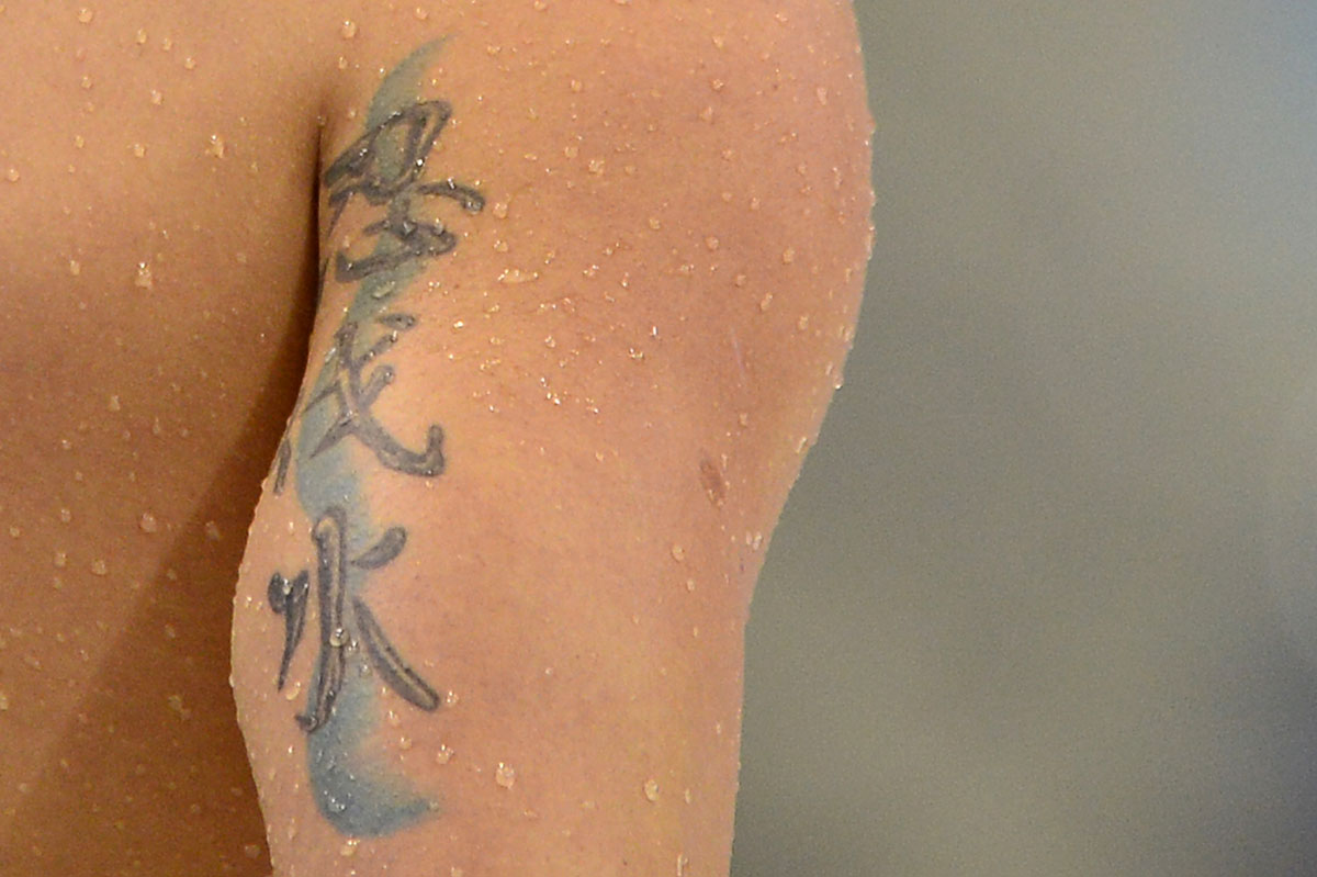 Olympic ink 50 more tattoos on the world s best athletes for Swimming after a tattoo