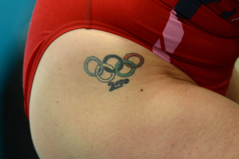 A swimmer bearing an Olympic rings tattoo gets ready prior to compete in the women's 50m freestyle heats during the swimming event at the London 2012 Olympic Games on August 3, 2012 in London. (Christophe Simon/AFP/Getty Images)