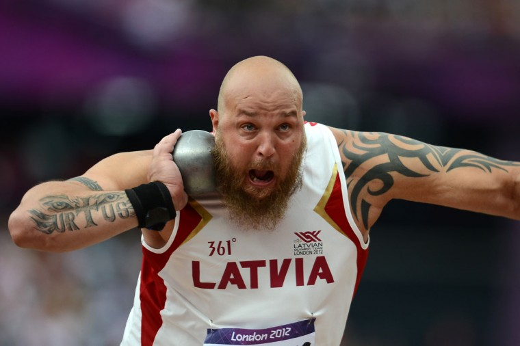 Latvia's Maris Urtans competes in the men's shot put qualifying rounds at the athletics event during the London 2012 Olympic Games on August 3, 2012 in London. (Fabrice Coffrini/AFP/Getty Images)