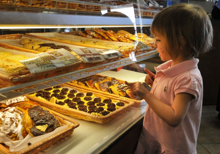 APRIL 16: Caroline Hirsch, 3, of Baltimore, examines the pastries at Goldberg's New York Bagels, which are not eaten during Passover by observant Jews. The bakery had an extra busy Sunday as Jewish customers stocked up on leavened bread products after Passover. (Amy Davis/Baltimore Sun)