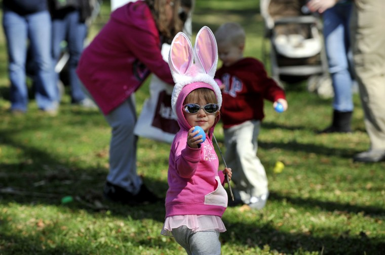 APRIL 9: Isabella Bowen, 22 months, Lusby, shows off one of the plastic eggs she found in the fields of Waterfowl Lake Pavilion at the Maryland Zoo in Baltimore. Bowen is on the hunt for Easter eggs during the annual Bunny BonanZOO. (Kim Hairston/Baltimore Sun)