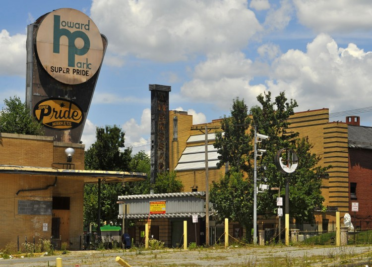 JULY 9, 2009: The Ambassador, an Art Deco theater built in 1935, was offered at a public auction today. At left is an abandoned supermarket, slated to be torn down to make way for a new shopping center. (Amy Davis/Baltimore Sun)