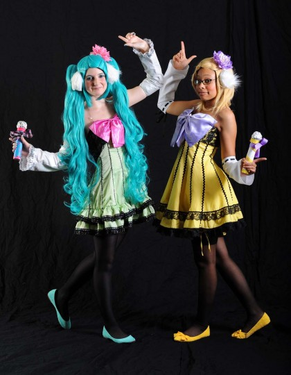 Melanie Hawkins, left, dressed as Hatsume Miku, of Vacaloid, and Angel Williams, drerssed as Rin Kagamine, both of Colonial Heights, Va., are pictured at the Baltimore Sun photo booth during the 2012 Otakon at the Baltimore Convention Center. (Kenneth K. Lam/Baltimore Sun)