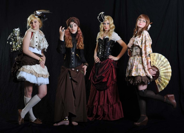Elizabeth Reindl, left, Emily McCann, Marina Salamon, all of Philadelphia, Pa., and Samantha Barbeau, of West Chester, Pa., all dressed as Steampunk characters for Otakon 2012. (Kenneth K. Lam/Baltimore Sun)