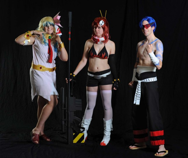 "Brenda Proctor, left, dressed as Nia Teppelin, Ann Darby, both of Newtown, Pa., dressed as Yoko Littner. Greg Nugent, of Sudbury, Ma., dressed as Kamina. All are characters in ""Gurren Lagann."" (Kenneth K. Lam)"