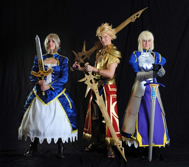 "Angie Moloney, left, of Baltimore, Md., dressed as Saber, Thontos John, of Fairfax, Va., dressed as Gilgamesh, and Gunkat Cosplay, of Washington D.C., also dressed as Saber, all characters in ""Fate."" (Kenneth K. Lam/Baltimore Sun)"