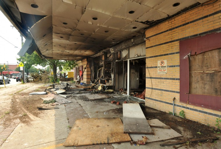JULY 5, 2012: Fire-damaged front entrance under the marquee of the former Ambassador Theatre. (Amy Davis/Baltimore Sun)