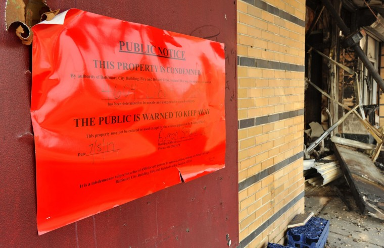 JULY 5, 2012: Baltimore City posted a large public notice saying the building at 4604 Liberty Heights Avenue was condemned. (Amy Davis/Baltimore Sun)