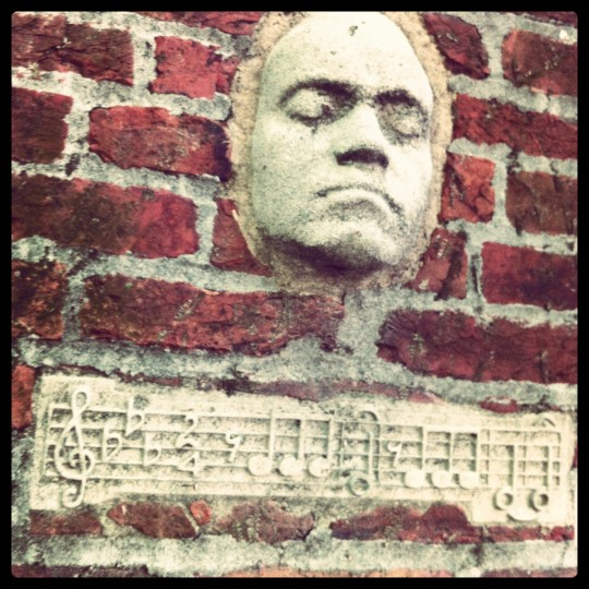 A face sculpture protrudes from a brick wall in the space behind famous Baltimore Sun journalist H.L. Mencken's house on Hollins Street in southwest Baltimore, May 27, 2012.