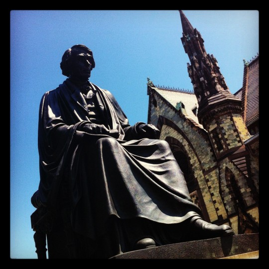 The statue of Chief Justice Taney in Mount Vernon is hit by the sun on May, 31, 2012, with the Mount Vernon Place United Methodist Church in the background.