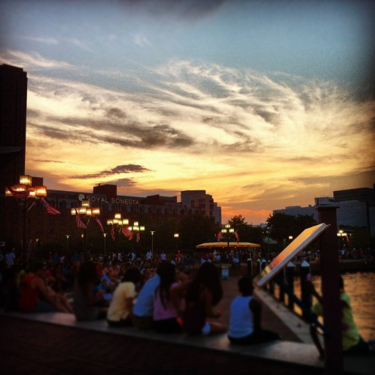 As the sun set over the Inner Harbor on July 4, 2012, colors emerged in the sky that were almost like a painting. I used a filter that enhanced the yellows and oranges and blurred the people toward the bottom of the photo.