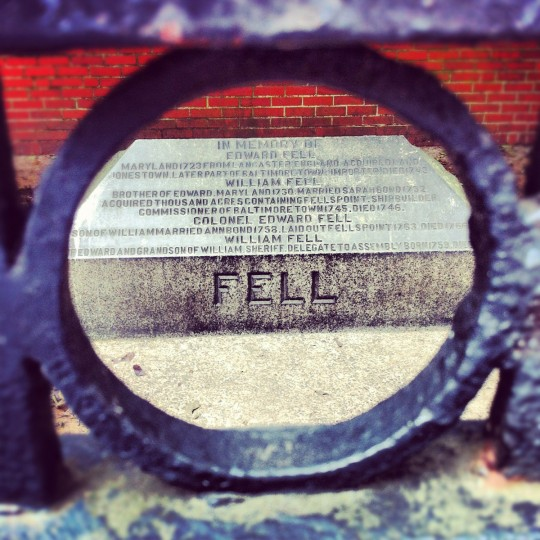 The memorial to Edward Fell in Fells Point is framed inside a hole in the iron gate in front of it, July 22, 2012.