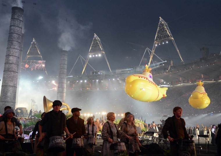 Two Beatles' Yellow Submarines float over and past performers during the Olympic Stadium in London, England, during the Opening Ceremony for the London 2012 Summer Olympic Games, Friday, July 27, 2012. (Chuck Myers/MCT)