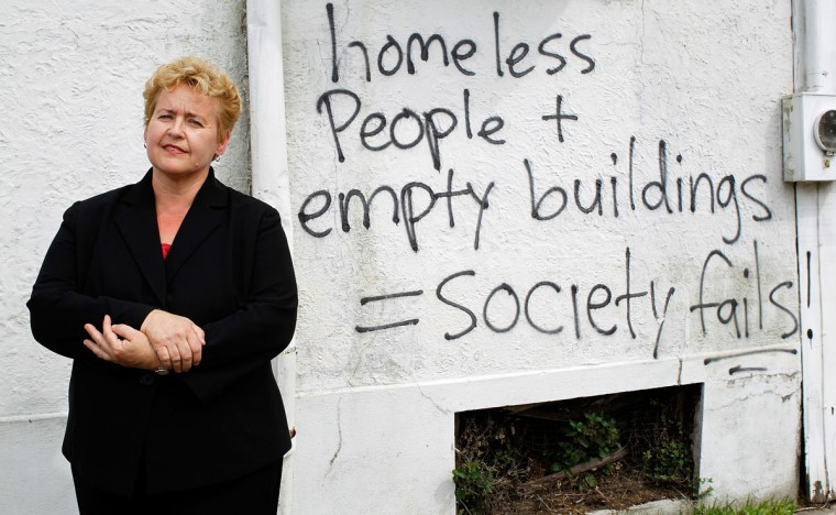 Martha Kegel, executive director of UNITY of Greater New Orleans, stands in front of graffiti on a blighted building in mid-city, Thursday July 12, 2012. Founded in 1992, UNITY is a nonprofit leading a collaborative of 60 organizations providing housing and services to the homeless. (David Grunfeld/MCT)