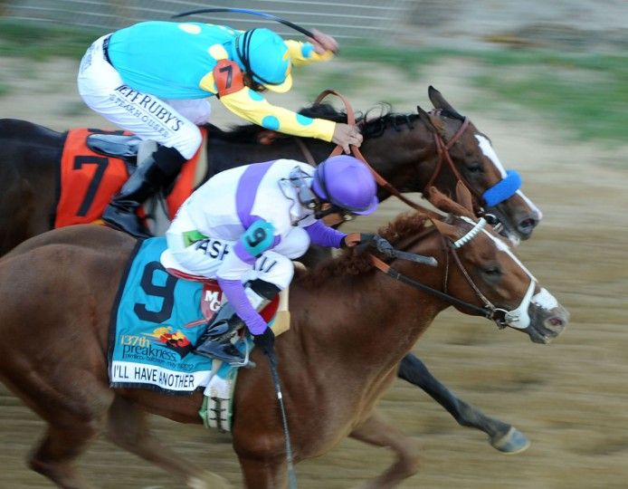 MAY 20: I'll Have Another (#9) overtakes Bodemeister (#7) in the final stretch to win the 137th Preakness Stakes. (Jerry Jackson/Baltimore Sun)
